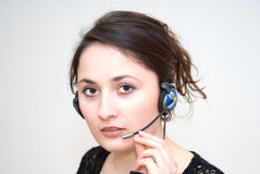 Telephone operator. A friendly / secretary / telephone operator with headphone Stock Images