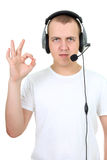 Telephone operator showing ok sign over white. Telephone operator  showing ok sign isolated over white Stock Photo