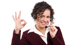 Telephone operator shows OK Royalty Free Stock Photos