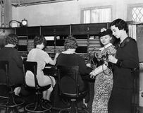 Telephone operators at switchboard Stock Photo