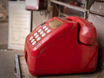 Telephone in outdoor. Red public button phone in India Stock Photography