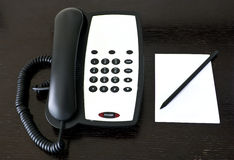 Telephone and paper Stock Photography