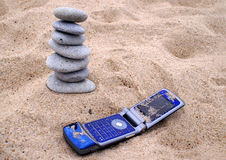 Telephone and pebble stack on. Stones balance, pyramid, background , telephone Royalty Free Stock Photography