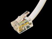 Telephone plug. Macro of telephone plug on a black background Stock Photo