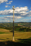 Telephone pole. And the cables on it, located in the countryside stock photo