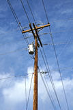 Telephone pole. Against the sky with lots of wires Royalty Free Stock Photos