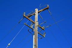 Telephone Pole. Close up of a telephone pole over blue sky Royalty Free Stock Photos
