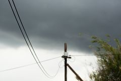 Telephone pole on a cloudy day stock image