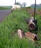 Telephone pole down. Telephone pole on the ground after being hit by a car Stock Photo