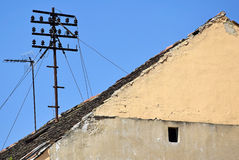 Telephone pole on the roof Stock Photo