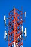 Telephone pole telecommunications tower on blue sky background Stock Photos