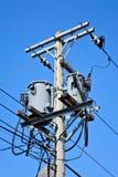 Telephone pole. Under the blue sky Stock Image