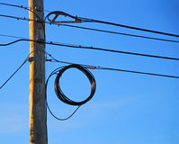 Telephone Pole and Wires. Telephone pole and communication wires in afternoon sun with bright blue sky Royalty Free Stock Image