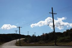 Telephone pole with wires on an empty street Royalty Free Stock Photography