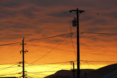 Telephone Pole and Wires at Sunset Royalty Free Stock Photo