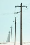 Telephone Poles. Fading in the distance stock photography