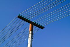 Telephone Poles and lines against a blue sky Royalty Free Stock Photography