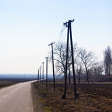 Telephone poles by the road Stock Photo