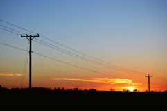 Telephone Poles at Sunset Stock Photos