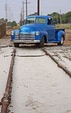 Telephone poles, train track, truck Stock Images