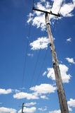 Telephone poles with wires. Wooden telephone poles with wires Royalty Free Stock Images