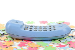 Telephone and puzzle Royalty Free Stock Photo