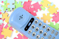 Telephone and puzzle Stock Photography