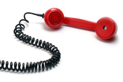 Telephone receiver. A red telephone receiver on white background Royalty Free Stock Photography