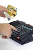 Telephone receiver and credit card Stock Photos