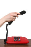 Telephone receiver in a female hand Stock Image