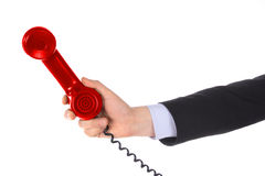 Telephone receiver in hand stock photography