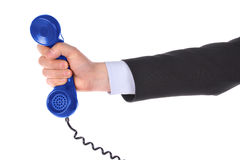 Telephone receiver in hand royalty free stock images