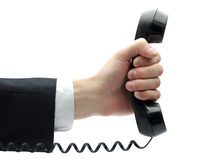 Telephone receiver in hand Stock Images