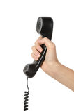 Telephone receiver in hand Stock Photos