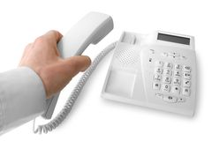 Telephone receiver in hand Royalty Free Stock Image