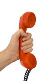 Telephone receiver in hand. Isolated on white background Stock Photography