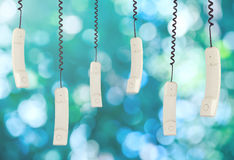 Telephone receiver hanging. Blue and green defocused background Stock Image