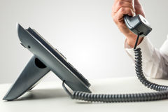 Telephone with the receiver held by a male hand Stock Images