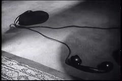 Telephone receiver lying on floor