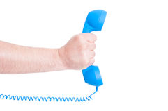 Telephone receiver in male hand stock photography
