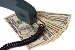 Telephone receiver and money Royalty Free Stock Images