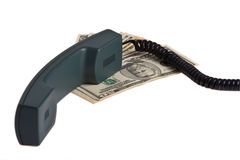 Telephone receiver and money Stock Image