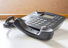 Telephone with receiver off hook. Image of telephone with receiver off hook  on table Stock Photography