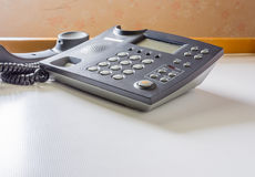 Telephone with receiver off hook. Image of telephone with receiver off hook  on table Royalty Free Stock Photos