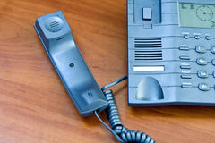 Telephone with receiver put aside. Office telephone with receiver put aside Stock Images