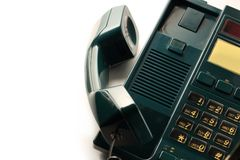 Telephone receiver. Stationary telephone receiver in closeup Royalty Free Stock Photo