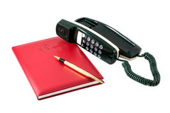 Telephone reference book. The telephone reference book with the handle and phone on a white background Stock Photography