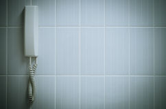 Telephone in a restroom Royalty Free Stock Photography