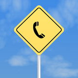 Telephone road sign. Closeup of telephone road sign with blue sky and cloudscape background Stock Images
