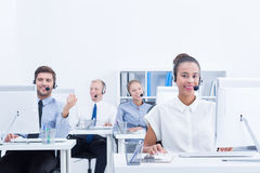 Telephone seller at work. Young and confident telephone seller at work in office Royalty Free Stock Photography